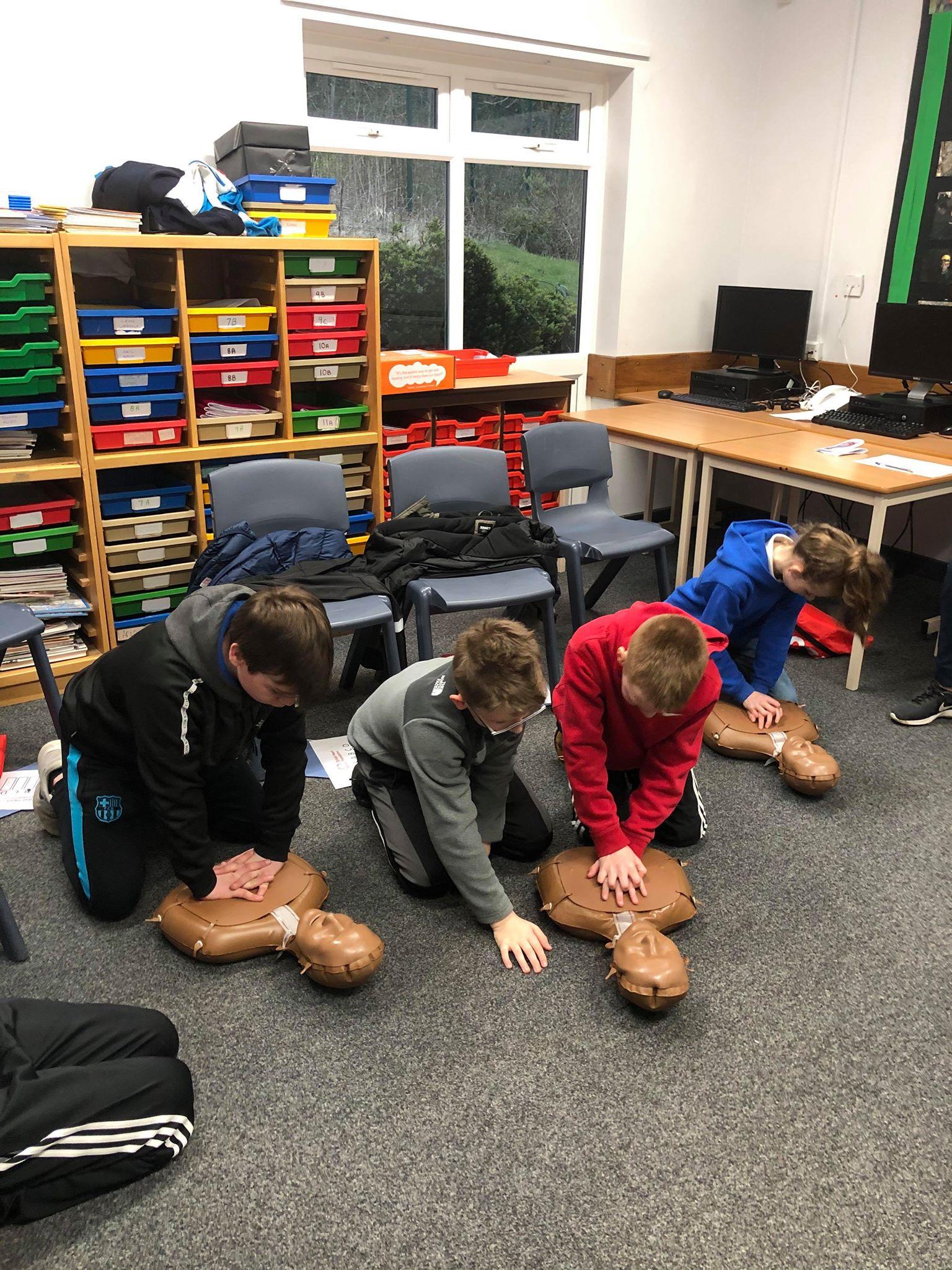 Children learning CPR